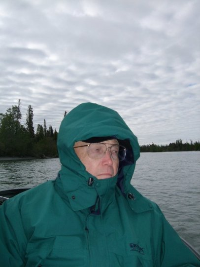Dad warding off the chill of a June Alaska morning.