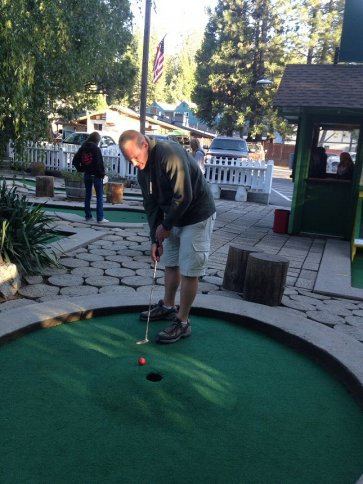 Sean lining up a putt on hole four at Twain Harte Miniature Golf.
