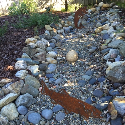 Faux creek bed and faux fish.