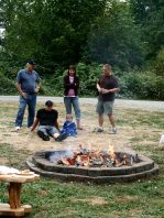Dad, Sean, Kenna, Levi and Mark around the fire.